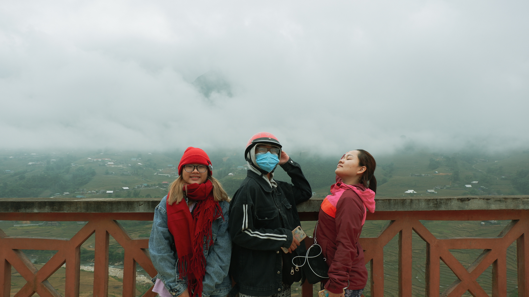 three girl with mountain background